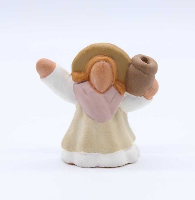 Femme a la cruche produit ancienne collection