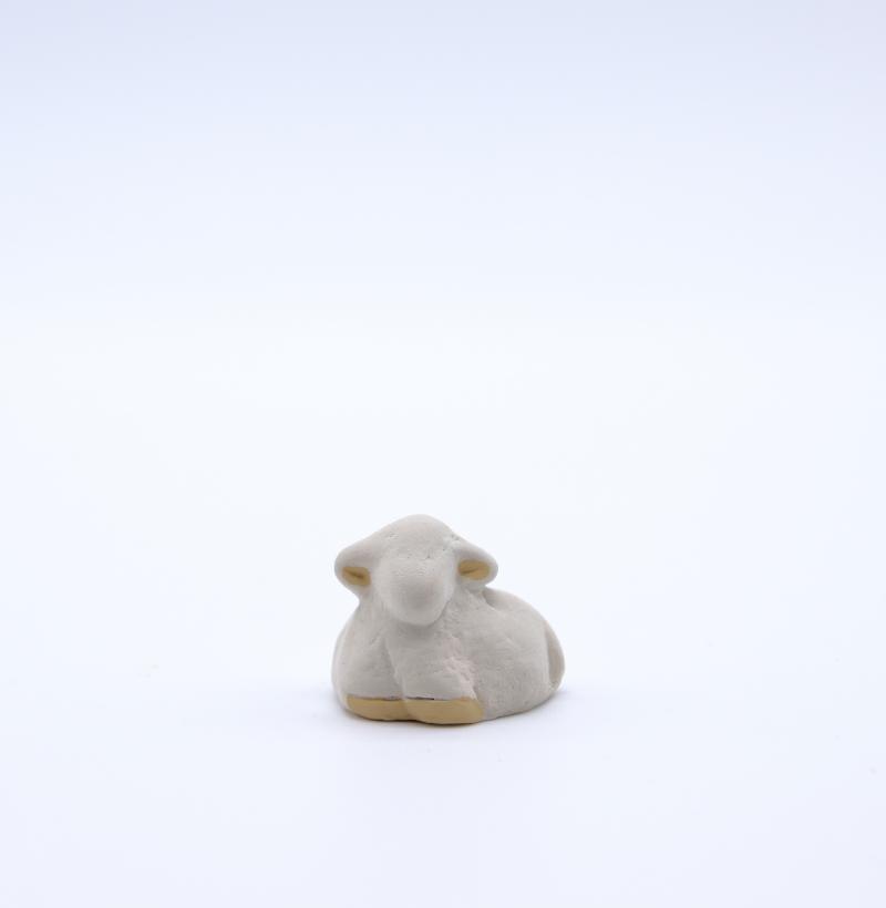 Mouton couché blanc produit petits animaux