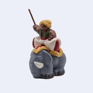 Cornac sur éléphant